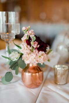 Rose Gold Vase with Eucalyptus, Pink Blossoms and Burgundy Dahlia , Rose Gold Vase, Rose Gold Centerpiece, Gold Vases, Centerpiece Decorations, Wedding Table Centerpieces, Flower Centerpieces, Flower Vases, Pink And Burgundy Wedding, Burgundy Decor