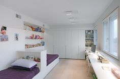 Minimal kids shared room - love the shared works space. Add some mirrors and could double as vanity