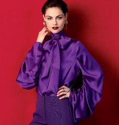V1416:  The color.  The crazy drape of the sleeves.