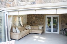 bespoke contempoary conservatory with bi folding doors and can also be called a sun room or orangery