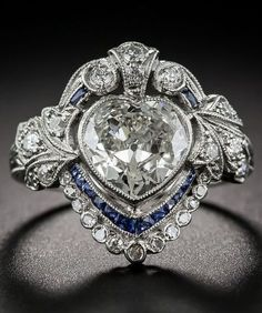 rubies.work/… An Edwardian Heart-Shaped Diamond and Sapphire Ring.