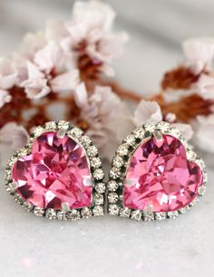 Pink Earrings,Pink Swarovski Earrings,Pink Crystal Heart Earrings,Valentines Gift For Her,Pink Statement Earrings,Heart Earrings,Pink Studs  IF YOU WANT THE BEST CHOSE THE ORIGINAL Petite Delights is an Official SWAROVSKI® Branding Partner Official Swarovski Elements® Partner Made with real genuine high quality Austrian Swarovski ©Crystal . Our brand is legally licensed & authorized By Swarovski Company for high quality manufacturing. This pair comes with Swarovski genuine tag , this is ...