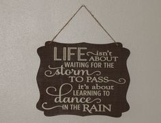 Life isn't about waiting for the storm to pass it's about learning to dance in the rain. hanging sign, Plaque, with vinyl saying