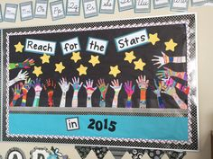 "New Year's Bulletin Board: Students trace their arm and hand and decorate it with goals, things special to them, etc. ""Reach for the Stars"" in the new year ahead."