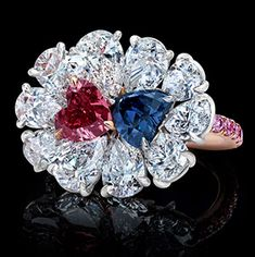The Argyle Red and Blue Twin Hearts Ring. Two of the world's rarest diamonds, discovered years apart in Australia's Argyle Mine, have been reunited in this platinum and rose gold ring: a 0.75-carat Natural Fancy Red diamond and a 0.78-carat Fancy Deep Bluish Violet diamond (total 1.53 carats, GIA Certified). While each heart-shaped stone is extraordinarily rare on its own, a pair so well matched in size and shape is considered incomparable.