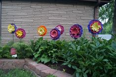 These are the flowers my Sister an I made with old LP vinyl records! Aren't they just cute!!!