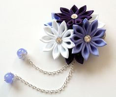 A flower is made in the technique of tsumami kanzashi. Alligator type hair clip . Flower is made from grosgrain ribbons. Swarovski crystals. Flower`s