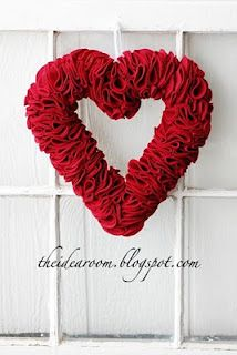 """many 3"""" red felt circles, foam heart wreath.  fold circle in 1/2 twice, then pin to foam wreath, continue until no foam is visible from front."""