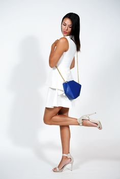 Kick up your heels and throw on the TRI cross body bag! www.pleatsdesign.com