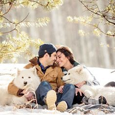 A love shoot in the snow with 2 cuddly white puppies. (Photography by Jason + Gina Wedding Photographers)