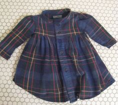Handmade Dress for baby from a mans flannel shirt. How adorable would it be to see your baby in your husbands clothes. Oh I just love this idea.