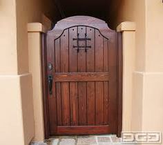 Old World designed courtyard gates reflect an aged broken-in look. Old world, drawing from the and Europe. Wooden Garden Gate, Wooden Gates, Garden Doors, Side Gates, Entrance Gates, House Entrance, Door Gate Design, Fence Design, Backyard Gates