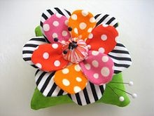 Flower pincushion, reminds me of a M.E illustration. I like the pattern fabric combinations