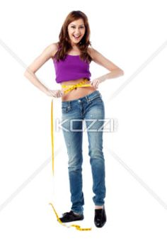happy young lady measuring her waist - Portrait of happy young lady measuring her waist isolated on white background