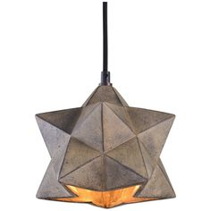 Antiqued concrete with black highlights and a rough hewn interior, give this geometric boulder pendant added interest. Features a black fabric covered cord. Details: - Designer: David Frisch - Wattage