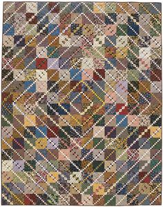 Timeless Treasure: Myriad prints and plaids compose the scrappy Triple Four-Patch blocks in this bed-size quilt.