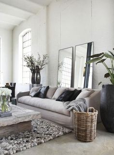 Living room design: Cement floors, white bricks, standing mirrors behind lounge. Neat modern touch. #home #decor #interior