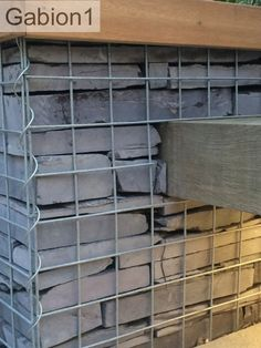 gabion seating detail, of inserting the seat into the gabion http://www.gabion1.co.uk