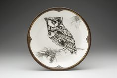 Small Round Platter: Screech Owl by Laura Zindel. Handmade ceramics are functional works of art, crafted from earthenware and glazed with non-toxic, low-fire glazes. Hand wash only. They are not to be placed in the dishwasher, oven, or microwave.