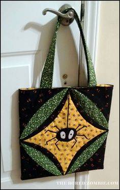 I saw a Cathedral window quilt for the first time a bee meeting a few months ago. Glue Gun Crafts, Cathedral Windows, Halloween Quilts, Trick Or Treat, Spider, Reusable Tote Bags, Holidays, Purses, Sewing