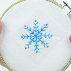 How to Embroider Snowflakes Three Simple Ways - Cucicucicoo Snowflake Embroidery, Christmas Embroidery Patterns, Simple Embroidery, Learn Embroidery, Embroidery Patterns Free, Hand Embroidery Designs, Cross Stitch Embroidery, Embroidery Works, Hand Embroidery Videos