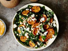 The flavor of raw collard greens combines perfectly with tender roasted sweet potatoes and tangy, rich goat cheese in this hearty starter.