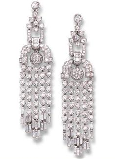 A PAIR OF ART DECO DIAMOND EAR PENDANTS, BY MAUBOUSSIN Each of chandelier design, the openwork geometric diamond surmounts supporting an articulated diamond sphere and diamond tassels, circa 1930, 9.0 cm long, with French assay marks for platinum Signed Mauboussin