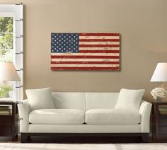 "Wooden Flag from Pottery Barn:  This substantial wooden flag is made entirely of recycled pine and then painted for a rustic finish.  50"" wide x 27"" high  Detailed with a distressed painted finish and sealed with lacquer for moisture resistance.  Hangs or mounts to the wall with the included D-rings."
