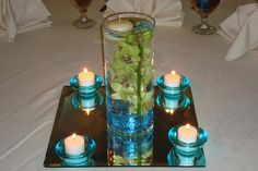 Turquoise and green centerpiece Use the same concept but instead change the colors to purple and sliver