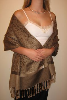 Buy evening shawls to contrast with your evening dress so the shawl is a focal point in the outfit.