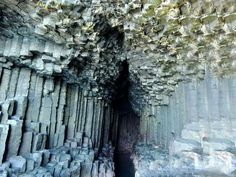 Fingal's Cave is a sea cave on the uninhabited island of Staffa, in the Inner Hebrides of Scotland.  Fingal's Cave is formed entirely from hexagonally jointed basalt columns within a Paleocene lava flow, similar in structure to the Giant's Causeway in Northern Ireland and those of nearby Ulva.