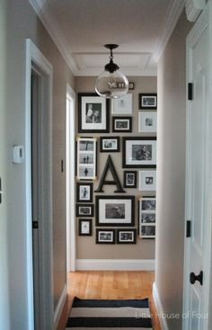 Gallery walls are nothing new, but positioning one at the end of a long hall is unexpected and delights passersby as they walk through the house. See more at Little House of Four »