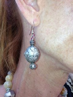 These beautiful silver earrings compliment the earthy collection of natural colors used for the one of a kind necklace. www.bonnieroseman.com