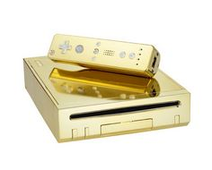 Gold Plated Nintendo Wii and controller (made for Her Royal Highness)