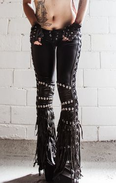 "TOXIC VISION Spiritchaser drainpipe pants | June 2015 | $499.00 Made from scratch out of black wet look spandex and genuine leather detailing, metal detailing all around, fringe and laces up legs... Size: Small | Measures: 30-36"" around the top (low waist) 7.5"" rise, 33"" inseam"