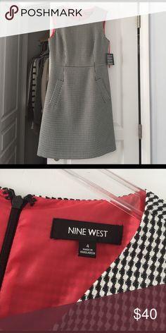 NWT Nine West dress size 4 Nine West size 4 NWT dress. Lovely pink lining and black and white print. Nine West Dresses