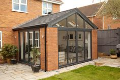 Solid roof sunrooms from Wessex Windows in Winchester come in various styles, colours and finishes. Get your free quote today! Solid roof sunrooms from Wessex Windows in Winchester come in various styles, colours and finishes. Get your free quote today! Garden Room, House Design, Garden Room Extensions, House Exterior, House Styles, New Homes, Modern Conservatory, Renovations, Roof Extension