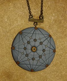 Geometric mandala pendant polymer clay necklace with by DannaGart, $37.00