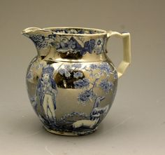 Antique English pottery pitcher in silver luster (Staffordshire or Yorkshire)