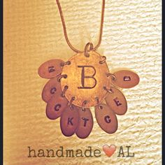 """The perfect gift for Grandmothers.  Grandmothers initial in the middle and all the grandchildren on the """"mini pennies."""" Find it on Penny Powers Jewelry FB page!"""