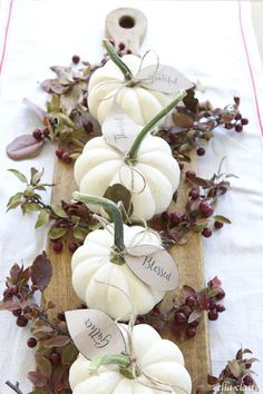 White pumpkins offer a subtle alternative to theirbrightly-colored cousins. Line 'em up on a wooden board for a perfectly rustic display. Get the tutorial at Ella Claire »