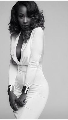 Love her hair, the dress the cuffs, the pose and the black and white photo!-SN