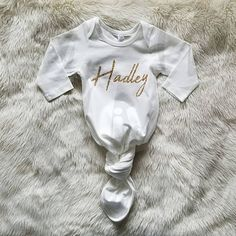 Our personalized knotted baby gowns with your babys name are the perfect baby shower gift for any newborn baby boy or baby girl. We offer these newborn baby gowns in the trendiest colors in the comfiest stretchy cotton knit, designed with babys comfort in mind, but also, lets be real, these are