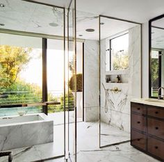 Gorgeous marble master bath. Gold frameless shower masculine modern simplistic wooden cabinets rustic loft