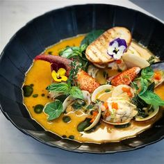 Red curry - coconut seafood Bouillabaisse.