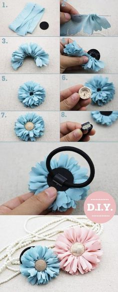 Handmade flowers with button centers. Could use a thin ponytail holder and just loop it through the shank.