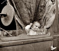 Baby from Mississippi in truck at the Farm Security Administration camp at Merrill, Oregon.  Dorothea Lange, 1939.