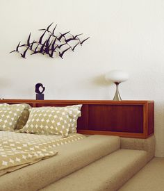 Like the sunken bed...not a fan of the carpet!   Extreme minimalism makes an impact when it comes to showing your stuff. A custom sunken bed in this midcentury modern desert home display...