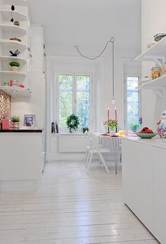 White swedish apartment with lots of tiny color accents.