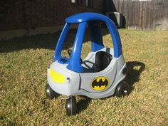 Batmobile in classic gray and blue made from a used Cozy Coupe.
